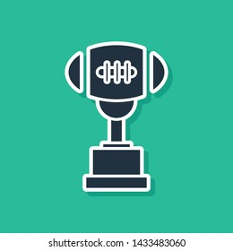 Blue Award cup and American football ball icon isolated on green background. Winner trophy symbol. Championship or competition trophy.  Vector Illustration