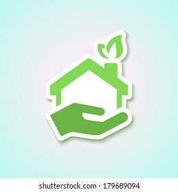 blue background with home icon in green. for ecology business