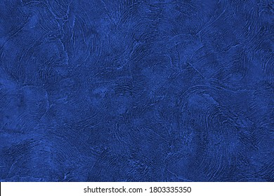 Blue background. Texture wall navy color. Abstract dark blue paint  pattern. Texture stone concrete wall. Rough grain backdrop plaster. Surface stucco. Design banner, wallpaper, poster, template, card