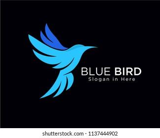 Blue bird, flying bird, bird on black background, dove flying logo,