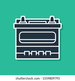 Blue Car battery icon isolated on green background. Accumulator battery energy power and electricity accumulator battery.  Vector Illustration