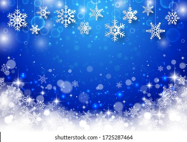 Blue Christmas background with snowflakes and glitter