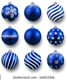 Blue christmas balls on white surface. Set of isolated realistic decorations. Vector illustration.