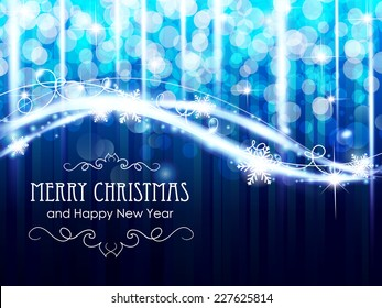 Blue Christmas and New Year background with sparkles and snowflakes