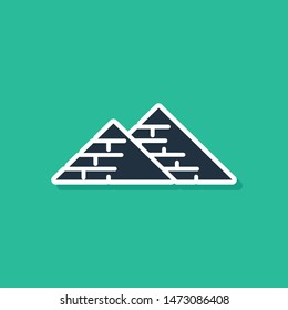 Blue Egypt pyramids icon isolated on green background. Symbol of ancient Egypt.  Vector Illustration