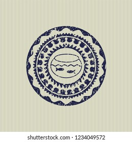 Blue fishbowl with fish icon inside rubber grunge texture seal