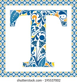 Blue floral capital letter T in frame made of Portuguese tiles