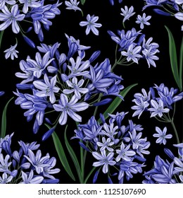 Blue flowers on a black background. Fashionable seamless pattern