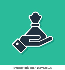 Blue Hand holding money bag icon isolated on green background. Dollar or USD symbol. Cash Banking currency sign.  Vector Illustration