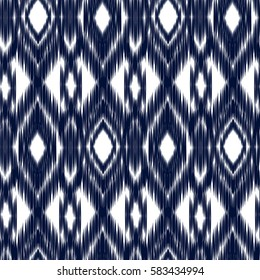 Blue Ikat Ogee Seamless Background Pattern. Abstract background for textile design, wallpaper, surface textures