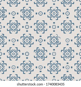 Blue Indian block print abstract floral seamless vector pattern background with stylised flowers for fabric, wallpaper, scrapbooking projects. Surface pattern design.