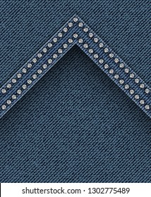 Blue jeans angle with silver spangles on jeans background.