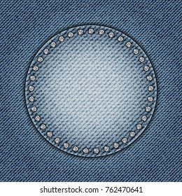 Blue jeans circle with diamonds on jeans background.
