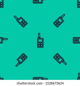 Blue line Walkie talkie icon isolated seamless pattern on green background. Portable radio transmitter icon. Radio transceiver sign.  Vector Illustration