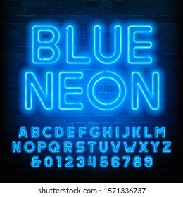 Blue Neon alphabet font. Uppercase neon light letters and numbers. Brick wall background. Stock vector typescript for your typography design.