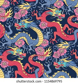 Blue and red dragons fighting in pink flowers on dark blue background. Seamless pattern for textile and decoration