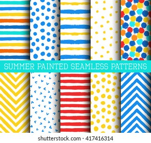 Blue red yellow white painted seamless patterns set. Distress texture grunge design.  Striped chevron and dot ornaments. Grunge paint backgrounds. Vector wallpaper or fabric print from brush strokes