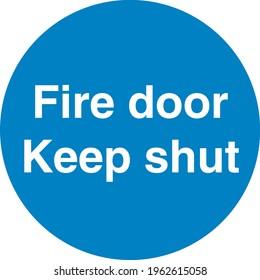 Blue sign board Fire door keep shut