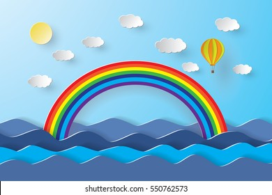 Blue sky and clouds with blue sea, rainbow and balloon. paper art style.