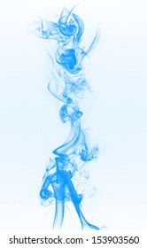 Blue smoke on the light blue background.