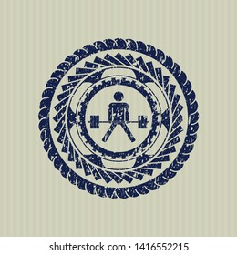 Blue sumo deadlift icon inside distressed rubber grunge seal