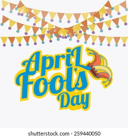 blue  text fool's day with flags over white color  background