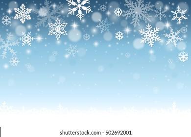 blauer Winterhintergrund mit fallenden Schneeflocken und Schnee