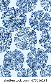 Blue woodblock printed seamless floral pattern. Eastern folk motif with abstract circular figures, looks like flowers. Indigo on ecru background. Textile print.