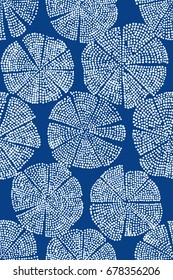 Blue woodblock printed seamless floral pattern. Handmade Eastern folk motif with abstract dotted circular figures, looks like flowers. Ecru on cobalt background. Textile print.