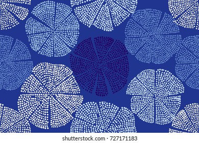 Blue woodblock printed seamless floral pattern. Eastern folk motif with abstract dotted circular figures. Textile print.