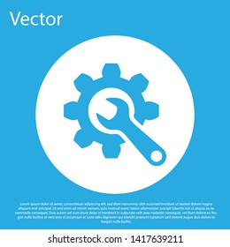 Blue Wrench and gear icon isolated on blue background. Adjusting, service, setting, maintenance, repair, fixing. White circle button. Vector Illustration