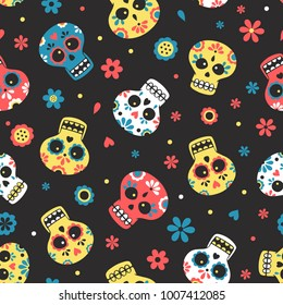 Blue, yellow and red mexican calavera day of the dead skulls with flowers on dark background seamlss pattern