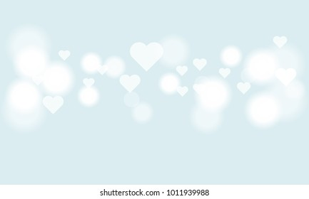 Blur heart bokeh for Valentines day holiday background. Luxury white light-colored.