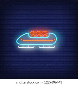 Bobsleigh neon sign. Glowing bob with sport team on dark blue brick background. Can be used for sport, winter games, Olympic