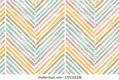 Bohemian chevron fashion print vector seamless pattern. Paintbrush strokes geometric stripes. Hand drawn paint texture zig zag chevron elements. Watercolor textile print seamless design.