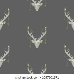boho seamless pattern with deer head with antlers, feathers and flowers, green leaves and wild berry sprig. Wild nature ornament on grey background. Ethnic vector print for paper and fabric