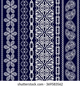Boho style seamless pattern. Set of stripes with floral motifs, geometric borders and paisleys. Ethnic textile collection. White on dark blue. Backgrounds & textures shop.