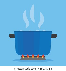 Boiling water in pan on stove. Blue cooking pot on stove with water and steam in the kitchen