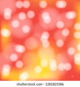 Bokeh glowing background in red, pink and yellow. Bright holiday design with circles. Magic flair