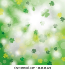 Bokeh of green shamrocks with sunlight. Eps 10 vector file.