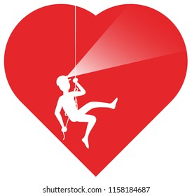 A bold explorer descending inside a heart while practicing rappel. He can accomplish his performance thanks to a rope, a helmet and a frontal torch