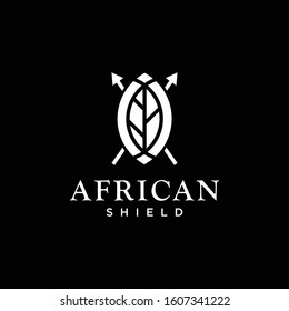 Bold logo design of african shield with leaf and black background - EPS10 - Vector.