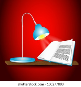 Book on the shelf with desk lamp