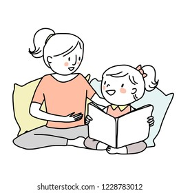 Booklover concept with smiling woman telling and reading a storybook to her daughter. Little girl reading a storybook with her mama. Mother spending happy family time with her child.