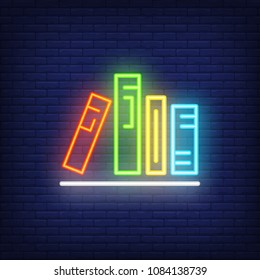 Books on shelf neon sign. Various colorful in row on shelf. Night bright advertisement. Vector illustration in neon style for literature and library