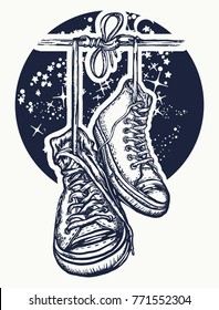 Boots hanging from electrical wire tattoo and t-shirt design. Symbol of freedom, street culture, graffiti. Sneakers on wires in space