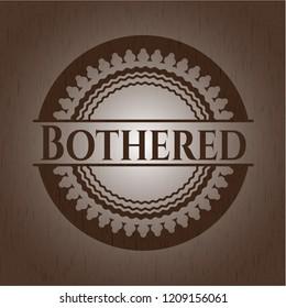 Bothered wooden emblem. Vintage.
