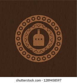 bottle of alcohol icon inside retro style wooden emblem