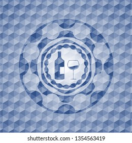 bottle and glass of wine icon inside blue polygonal badge.