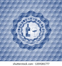 bottle and glass of wine icon inside blue badge with geometric background.